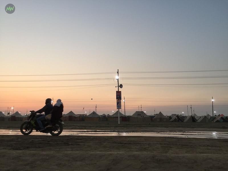 A man riding bike in an evening at Kumbh Mela 2019