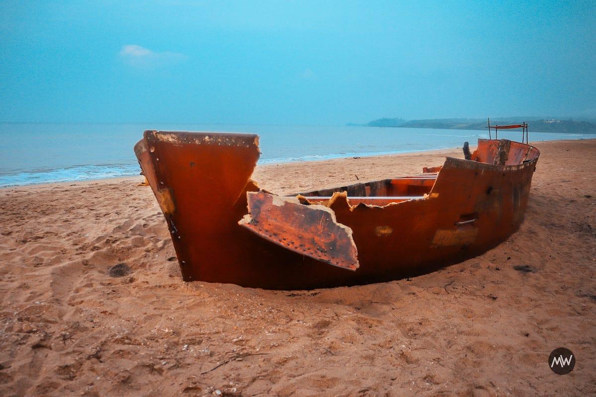 A wrecked boat at Keri Beach, North Goa
