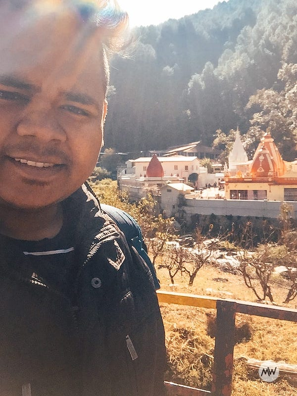 Me standing in front of Kainchi Dham