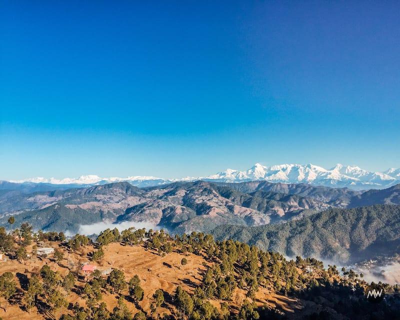 Snow peaked Himalayas at Kasar Devi