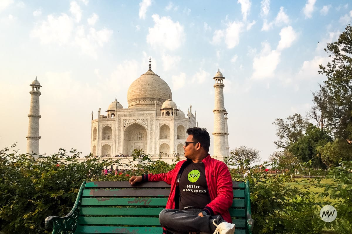 VivaciousVipin sitting and posing in front of the taj mahal virtual tour