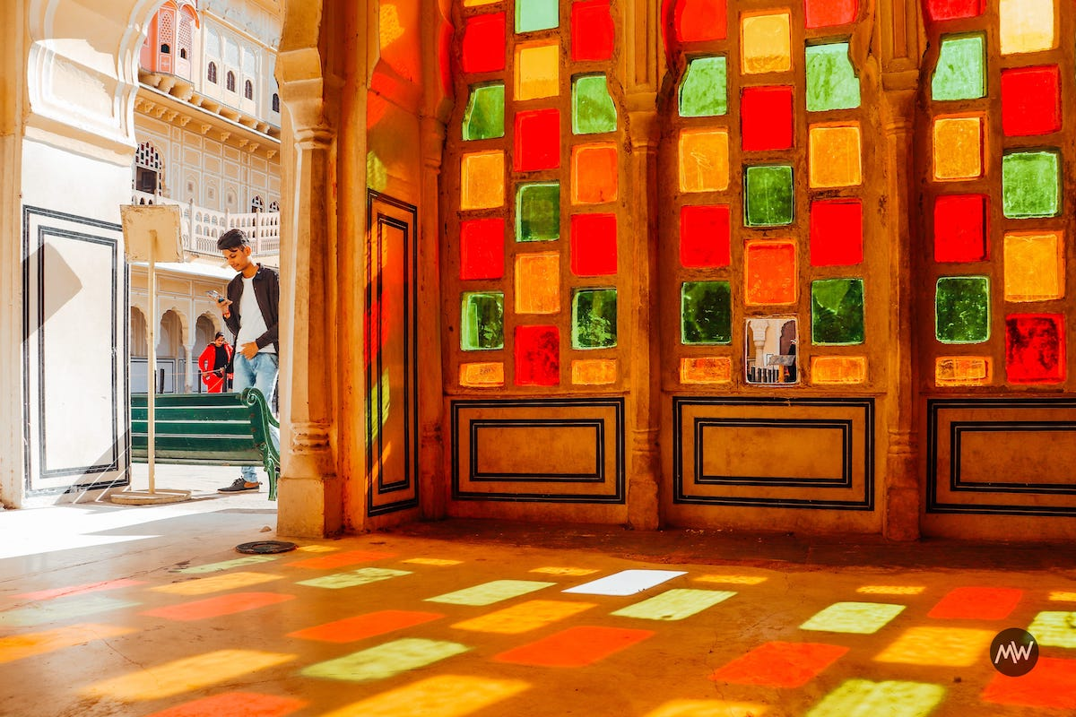 6.1 Colorful window on one side of hallway at Hawa Mahal Breeze Place  Wind Palace virtual tour