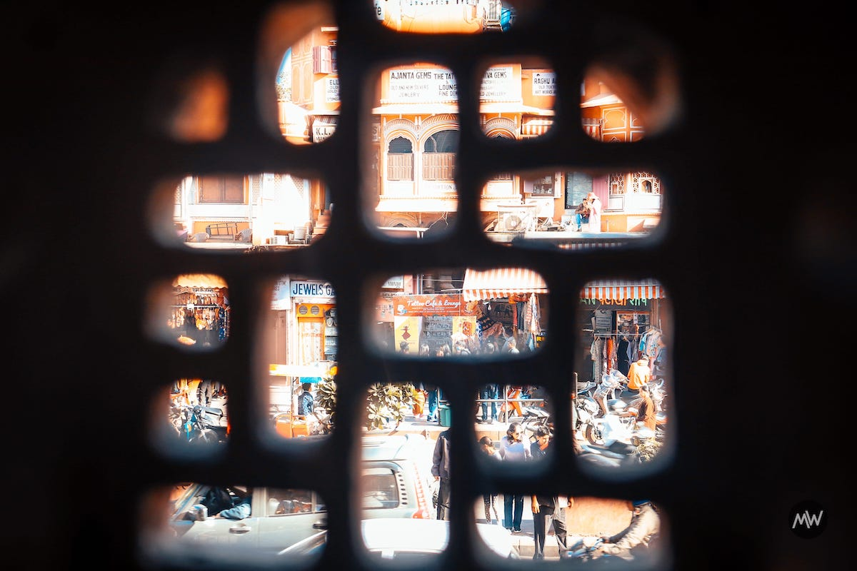 6.2 You see market activities from another window at Hawa Mahal Breeze Place Wind Palace virtual tour