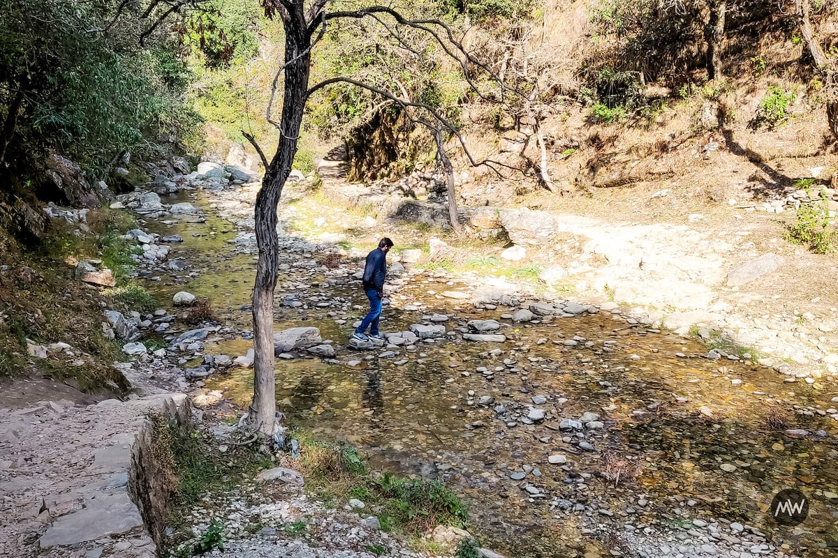 Following the trail through hilly streams to the waterfalls - Mukteshwar Dham