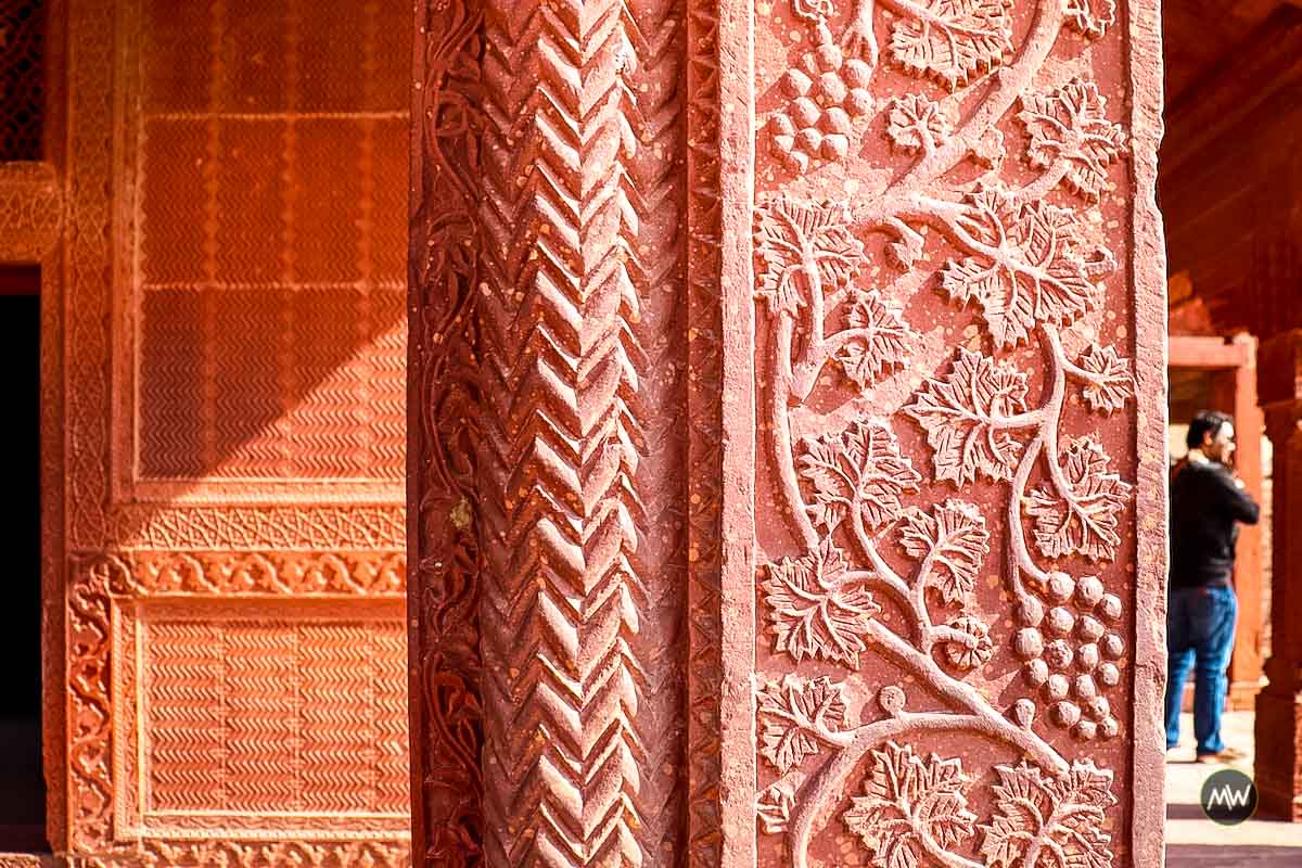 A beautiful carving on a column inside girls school at Fatehpur Sikri