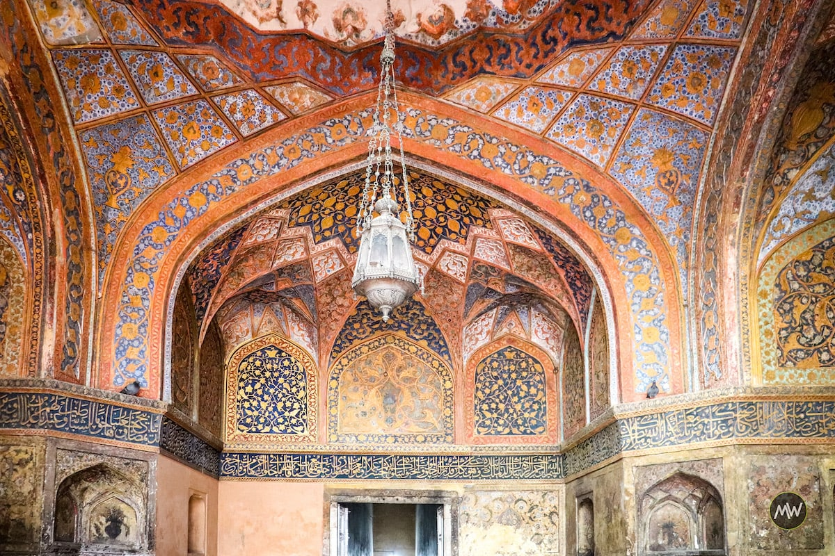 The lamp and beautiful artistry on the walls of the mausoleum