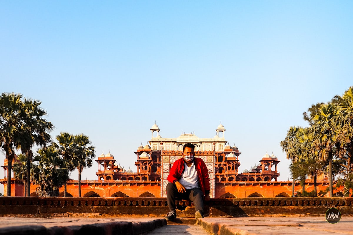 Vipin sitting in front of The mausoleum of Akbar at Sikandra